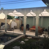 covered patio off of pool