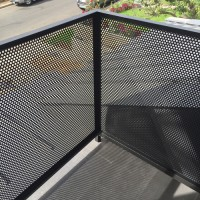 detail of perforated metal exterior rail